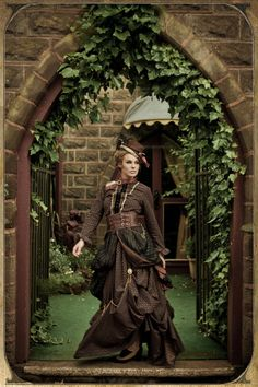 Day Dresses - Clockwork Butterfly - Steampunk lady in a castle's stone archway, trimmed with Ivy. Steampunk Dress, Steampunk Costume, Steampunk Clothing, Steampunk Fashion, Steampunk City, Steampunk Outfits, Victorian Steampunk, Victorian Gothic, Girls Twitter