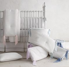 RH Baby & Child's Vintage-Washed Diamond Matelassé Crib Bumper:Matelassé – a fabric famous for its lush thickness and quilt-like stitching – is a classic choice for the nursery. Gently washed for an extra-soft matte finish, our bedding collection is stitched in a quintessential diamond pattern and trimmed with contrast piping.