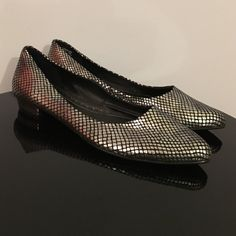 """Naturalizer Silver Foil Pointy Toe Heeled Flats Up for grabs is this pair of shoes from Naturalizer. They are a size 7 M with 0.75"""" block heels. These flats have a block heel to give a little extra height and pointy toes. They have a silver foil snakeskin-like print. A few areas have a few missing silver flakes but it's not that noticeable. Otherwise, they are in great condition. The price reflects this defect. Naturalizer Shoes Flats & Loafers"""