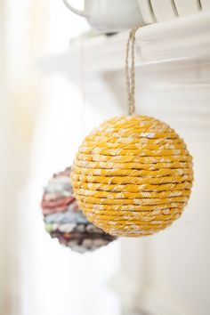 Easy DIY Wrapped Ball Ornaments, need: some styrofoam balls, an old catalog or newspaper, or fabric, a hot glue gun and some string