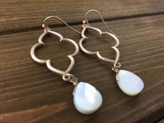 Matte Gold Tone Earrings with Open Quatrefoil and Ivory Stone