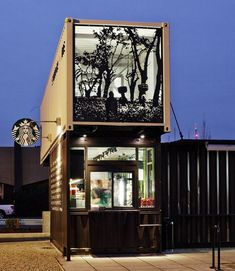 Repurposed shipping container drive-thru for StarBucks in Tukwila, Washington. Although drive-thrus are not green, Anthony P., global store design senior manager for Starbucks says the 'reclamation drive-thru was inspired by a desire to help keep items used throughout our supply chain, like old shipping containers, out of the waste stream.'