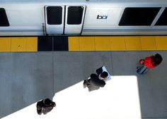 Passengers wait patiently to board the BART train at the Millbrae station on Friday. Three people have been found under BART trains in the past week, including a woman Friday morning in Daily City. Bay Area Rapid Transit, Locomotive, Over The Years, California, Train, Usa, Board, Photography, Photograph