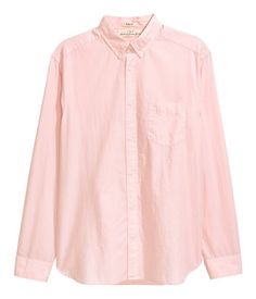 Light pink. Long-sleeved shirt in a cotton weave with a button-down collar, chest pocket and yoke with a hanger loop at the back. Regular fit.