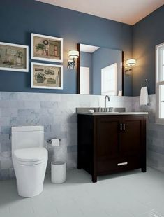 Make your bathroom remodel a modern masterpiece. paint your walls opulent navy and install a gorgeous white and blue tile wainscot wall halfway up from the Gray Bathroom Decor, Wainscoting Bathroom, Bathroom Paint Colors, Bathroom Floor Tiles, Bathroom Ideas, Wainscoting Ideas, Bathroom Accessories, Bathroom Laundry, Funny Bathroom