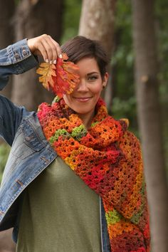This is a chunky lace shawl that celebrates the kaleidoscope of colorful autumn foliage.  Super cozy and beautiful, it is a go-to piece for the cooler months ahead.  Worked flat with a simple fan stitch, this project is great for beginners, too.