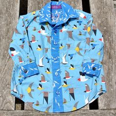 One-of-a-kind handmade button-up shirt for boys in Charley Harper bluebirds…