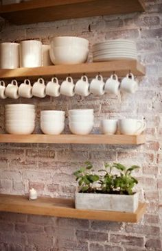Pretty, light wood kitchen shelves.