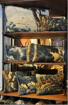 Great collection of pillows made out of tapestries.