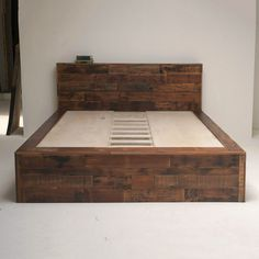 Amazing bed made of salvaged wood.