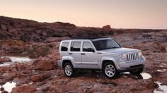 Jeep® Liberty shown in Bright Silver Metallic with available Sky Slider® Roof.