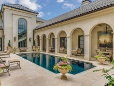 Love the colour of this house and the pool area especially the arch detail which would be great for the patio area if extended a bit further forward, to allow for a partly under covered pool