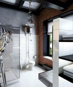 salle de bains de style industriel avec un mur de briques et aspect béton, suspension en métal et cabine de couche