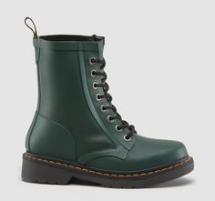 Our traditional 1460 8-eye boot, with laces, but completely waterproof, made of vulcanised natural rubber to create the perfect footwear for mud and moshpits everywhere. An absolute must-have for this year's Festivals, the new Drench Wellington will keep your feet warm and dry. Our classic 1460 silhouette is transformed into our Drench Wellington Boot. Vulcanised Natural Rubber Construction to achieve greater strength. Smoke Rubber Air Cushion Sole Eva Moulded Footbed with Black Fleece ...