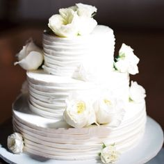 Simple white buttercream wedding cake with white cabbage roses // Wendy Laurel Photography