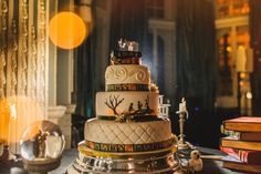 Harry Potter wedding cake, complete with House crests, an ode to 'The Tale of the Three Brothers,' and Bellatrix and Voldemort Lego cake toppers