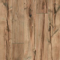 The most beautiful faux hardwood flooring I've seen - Shop Pergo Max 5.23-in W x 3.93-ft L Providence Hickory Handscraped Laminate Wood Planks at Lowes.com. Splurge on good noise reduction subflooring. It pays off!