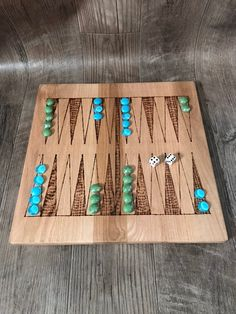 """Each game is handcrafted from hardwood, burned and sealed for longevity. The game is approximately 16"""" x 16"""". The game board will come with appropriate number of marbles and dice, along with the rules for the game. Marble colors will be given at random. Each game board will be very"""