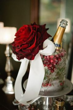 Winter wedding decor idea - cranberry + rosemary champagne bucket with red rose detail {The Studio B Photography}