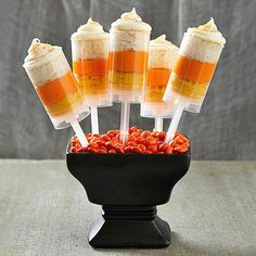 Your little goblins will love assembling -- and eating -- these spooky Halloween treats and sweets. From chocolate-dipped owl pretzels and candy corn push-up pops to jack-o'-lantern cookies and peanut butter (eye)balls, we have the best treats (and savory snacks!) to make your Halloween party a spooky success.