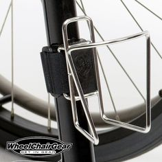 """Wheelchair Accessories Wheelchair Water Bottle Holder. Manufactured with a stainless steel frame and the best clamping system on the market today.Attaching to your chair, crutches or walker is quick and secure with the """"no scratch"""" rubber grommet along with the adjustable Velcro tightening strap.  CLICK HERE http://www.wheelchairgear.com/product/wheelchair-water-bottle-holder/"""