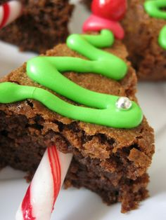 Brownie cut into a triangle, icing and a peppermint stick - so cute, so simple!