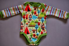 Cute indian onesie for boys with Ottobre pattern and cute indian illustration woodland print. Little Smilemakers fabric design. Made by Schnabelina