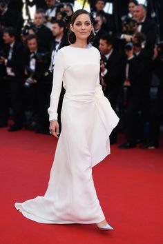 #Marion_Cotillard_style_2013 #Cannes_2013_Best_Dressed Marion Cotillard in a white long sleeve Christian Dior dress. Cannes Film Festival 2013. Photo: Venturelli, WireImage