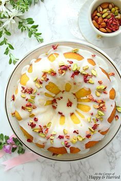The is a fragrant, rich and beautiful cake. This version has notes of rose, cardamom and in the cake, a on top, and is decorated simply with pistachios and petals. Persian Desserts, Persian Recipes, Just Desserts, Dessert Recipes, Middle Eastern Recipes, Love Cake, Macaron, Let Them Eat Cake, Beautiful Cakes
