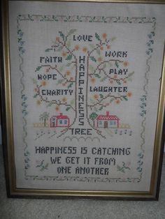 Vintage Cross Stitch Happiness Tree  Framed Sampler Needlework Wall Hanging. $19.99, via Etsy.