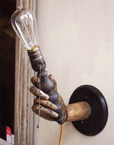 light held by an old wooden hand. ---- cool lamp but i want to get a hand model and put it on a base and hang it on the wall! Lampe Steampunk, Steampunk House, Steampunk Design, Steampunk Halloween, Steampunk Diy, Steampunk Wedding, Steampunk Furniture, Steampunk Interior, Wooden Hand