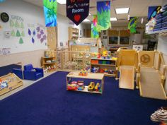 Infant Classroom Design | Infant and Young Toddler Room- use hanging banners in your decorating