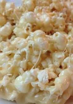 Marshmallow Caramel Popcorn ~ If you've never made this stuff, you are in for a real treat. It is SO .... Gooey. This stuff is awesome! Perfect movie night treat!!