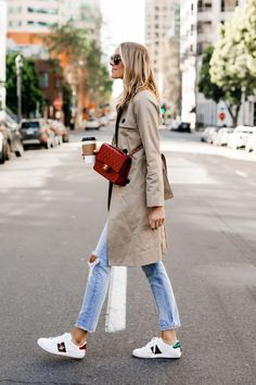 a45a361c2a44 Fashion Jackson Wearing Everlane Trench Coat Ripped Jeans Gucci Ace  Embroidered Sneakers Red Chanel Handbag