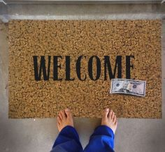 Welcome Door Mat With a Fake 50 Dollar Bill On It