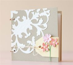 Tiny Tag & Flowers Notebook. Make It Now with the Cricut Explore machine in Cricut Design Space and Cuttlebug.