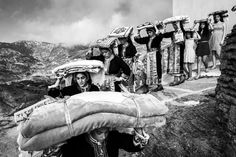 GREECE. Dodecanese, Karpathos island. Olympos village. Transportation of the groom's dowry to the bride's place. Pre- wedding traditional custom