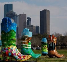 Houston skyline with large colorful Cowboy boots in the foreground. #streetart http://www.pinterest.com/TheHitman14/art-of-the-streets/