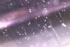 Dotted streams of exsolved Bohmite crystals in Grape-coloured Spinel from Sri Lanka.