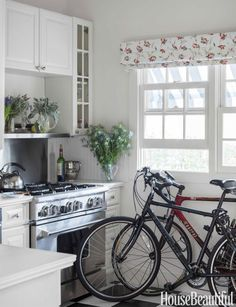 A lot of life near the beach takes place outdoors. Bicycles are temporarily parked in the kitchen, next to the Garland range.
