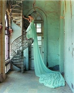 I love the composition of the photograph.The textures of the walls, the stairs, and the dress make it more interesting.