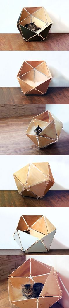 The Geobed is an icosahedral kitty temple. Made out of triangular wooden pieces and fixtures, this easy to assemble cat-bed is the perfect space for your feline! It's cozy and covered; and is really easy to put together! #Cat #House #Design #Wood #Material #YankoDesign #Pet #Lovers #Innovative #Creative