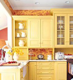 intense yellow kitchen w/orange wallpaper