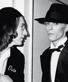 John Lennon and David Bowie, New York 1975 - Photograph by Ron Galella. This is taken at Studio 54. Lennon worked on FAME w/Bowie, the song.