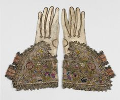 Pair of gloves, first half of 17th century. English. Leather; canvas worked with silk and metal thread; tent, Gobelin, detached buttonhole variations, and plaited braid stitches; metal bobbin lace; silk and metal ribbon
