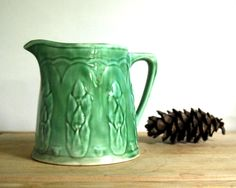 Vintage Pitcher Green Asparagus Milk Pitcher Yellowware Rustic Cottage Chic Antique. $38.00, via Etsy.