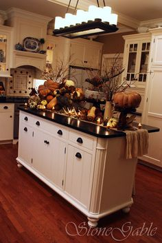 FINALLY figured it out!  Wood floors, white cupboards, blank counter tops AND I want THIS island!!!!