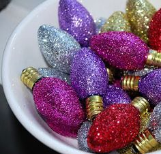 Burnt out lights, dipped in glitter - great decor idea!