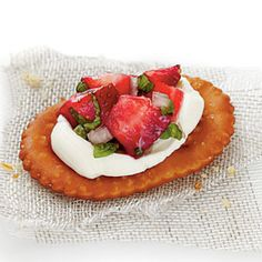 The sturdy pretzel holds the weight of the strawberries and cream cheese making this bite-size Strawberry Pretzel Crostini an ideal finger food.