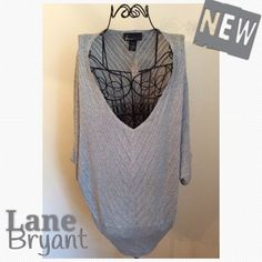 Metallic Silver Cacoon Sweater This is a Very Pretty Silver Metallic Sweater. Perfect if you don't like Heavy Sweaters. Goes Perfect with a Lace Camisole underneath. Material is 87% Rayon, 9% Polyester, 4% Other Fiber. Lane Bryant Sweaters V-Necks